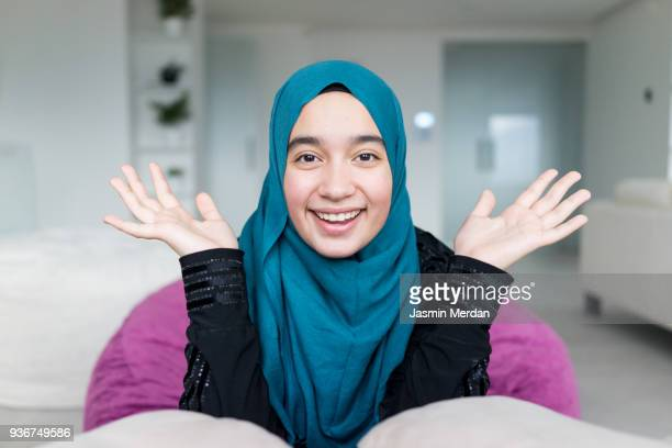 happy muslim girl - moroccan girls stock photos and pictures