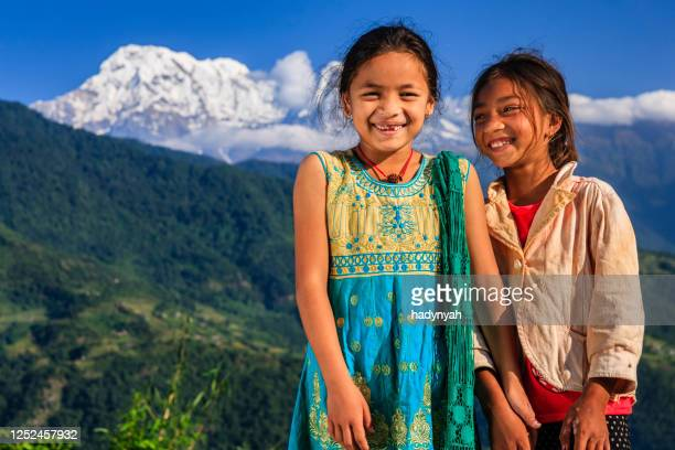 happy nepali little girls, annapurna range on background - annapurna south stock pictures, royalty-free photos & images