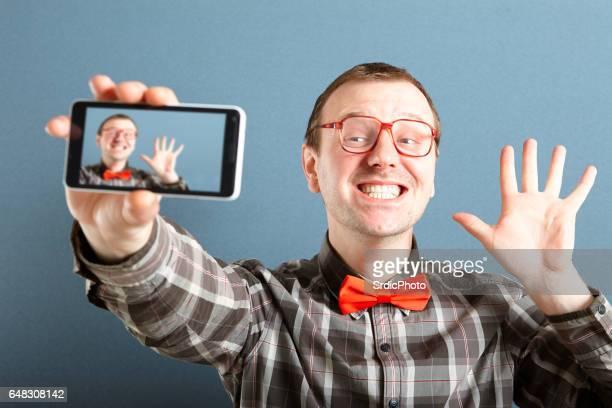 Happy nerd guy taking selfie photo