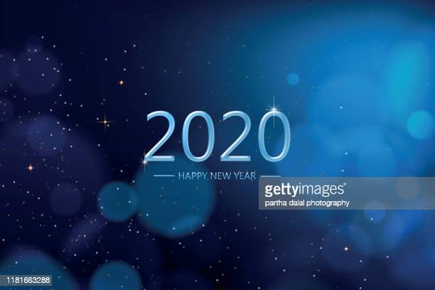 happy new year 2020 on blue bokeh background - 2020年 ストックフォトと画像