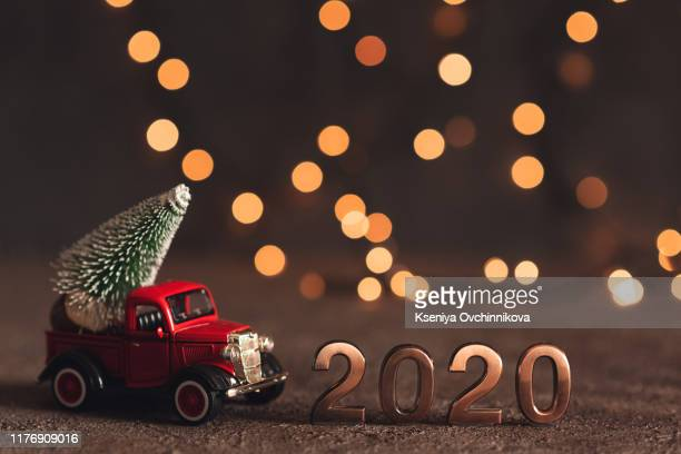 happy new year 2020. symbol from number 2020 on wooden background - 2020 calendar stock photos and pictures