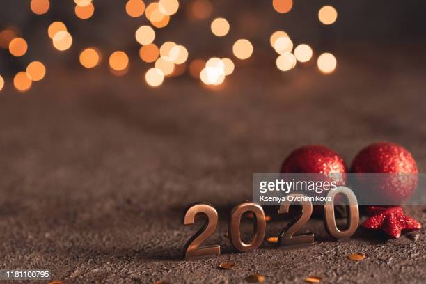 happy new year 2020. symbol from number 2020 on wooden background - happy new year 2020 stock photos and pictures