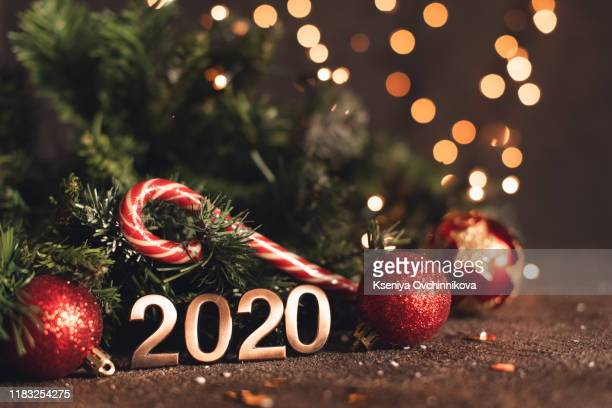 happy new year 2020. symbol from number 2020 on wooden background - new year 2020 stock photos and pictures