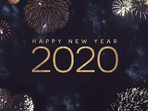 Happy New Year 2020 Text with Gold Fireworks in Night Sky 1170576396