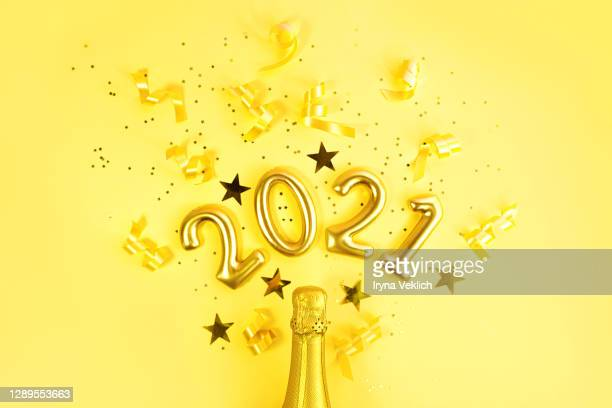 happy new year 2021 celebration with champagne in trendy yellow colour. - new year stock pictures, royalty-free photos & images