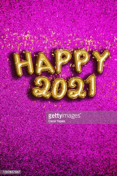 happy new year 2021 foiled golden balloon in purple background with confetti - new year's eve stock pictures, royalty-free photos & images