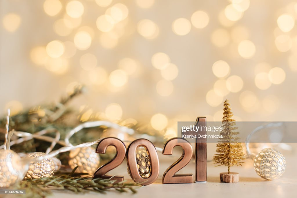 Happy New Year 2021 Golden Digits 2021 With Christmas Hat Are On Black Background With Bokeh ...