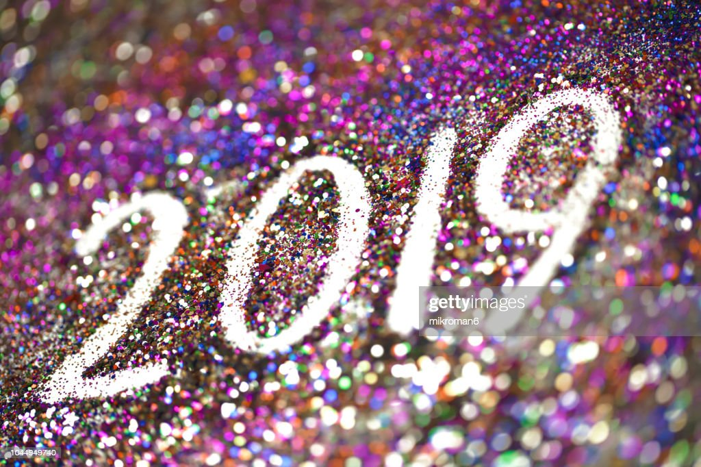 2019 Happy New Year background Multicoloured  glitter : Stock Photo