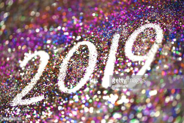 2019 happy new year background multicoloured  glitter - vigilia di capodanno foto e immagini stock