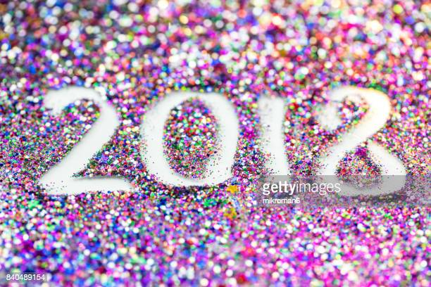 2018 happy new year background multicoloured  glitter - 2018 - fotografias e filmes do acervo