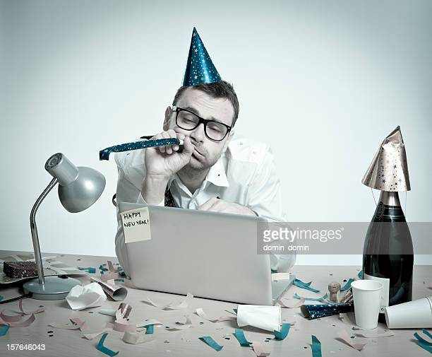 Happy New Year, hungover man behind laptop, office interior, retro