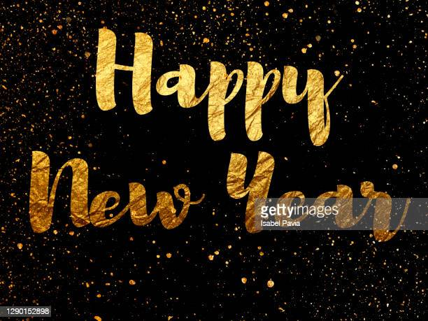 """happy new year"" message in golden words - new year's eve stock pictures, royalty-free photos & images"