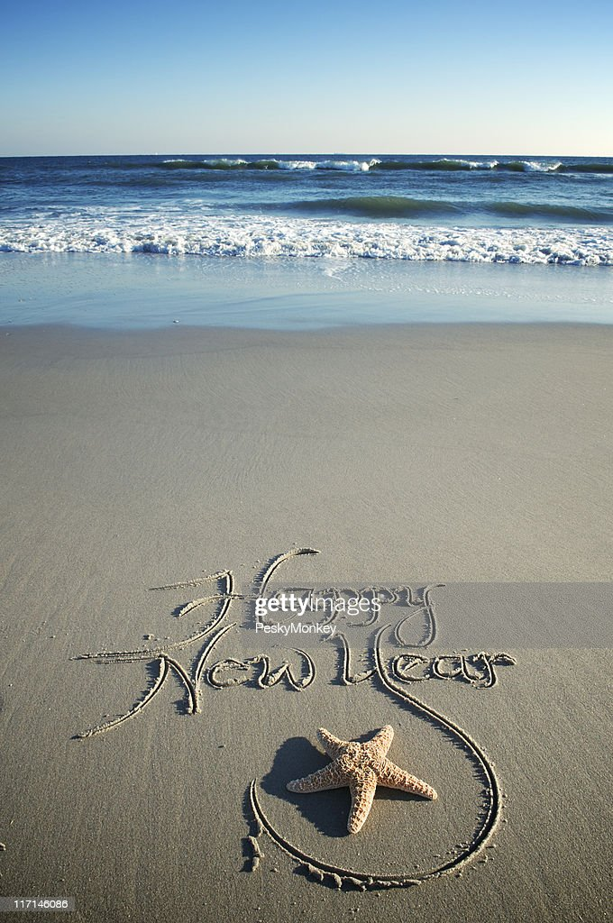 Happy New Year Message w Starfish on Smooth Beach : Stock Photo