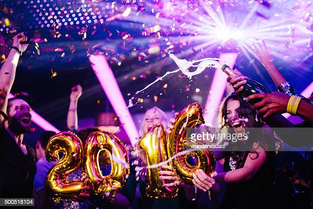 Happy New Years Eve Party in Nightclub with friends