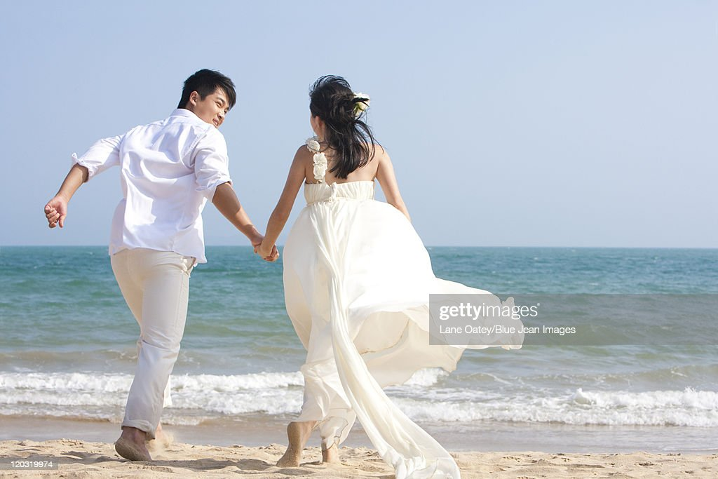 Happy Newlyweds on the Beach : Stock Photo