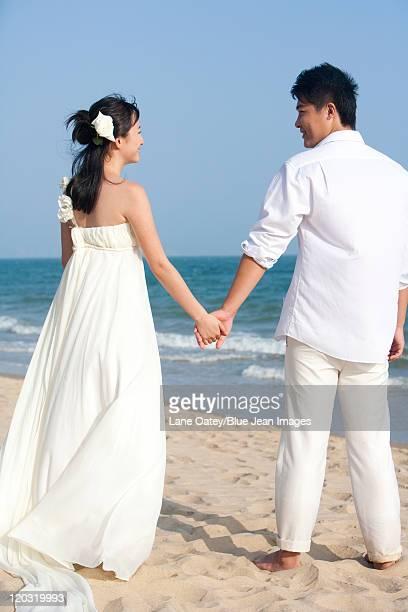 Happy Newlyweds on the Beach