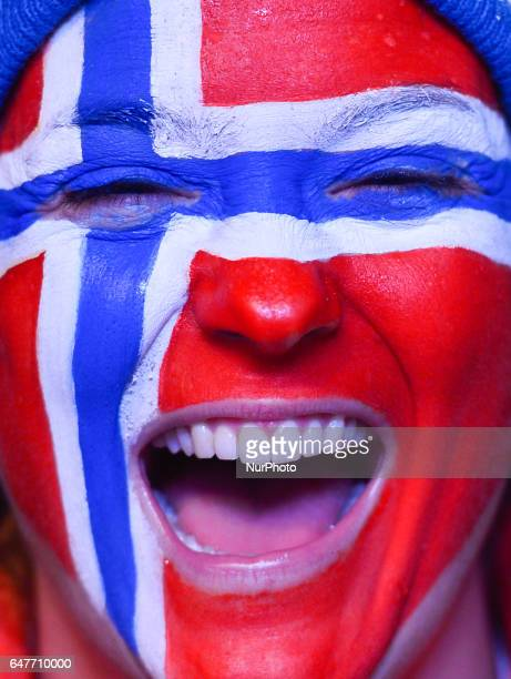 A happy Norwegian fan calebrates during the Awards Ceremony of Men crosscountry 4 x 100km Relay during the Awards Ceremony at FIS Nordic World Ski...