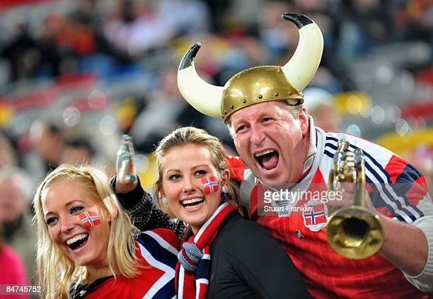 Happy Norwegian football fans watch the International Friendly match between Germany and Norway at the LTU Arena Duesseldorf on February 11 2009 in...