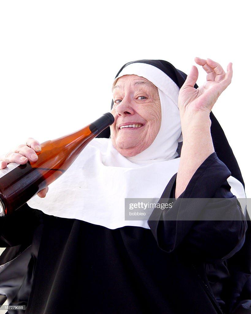 Happy Nun Drinking : Stock Photo