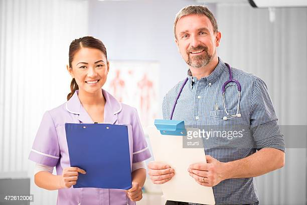 happy nurse and doctor portrait - outpatient care stock pictures, royalty-free photos & images