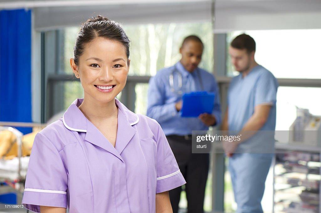 happy nurse on a busy ward : Stock Photo