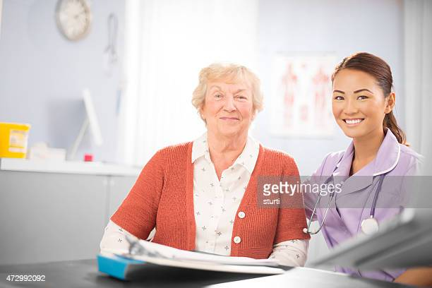 Happy nurse  with happy senior patient .
