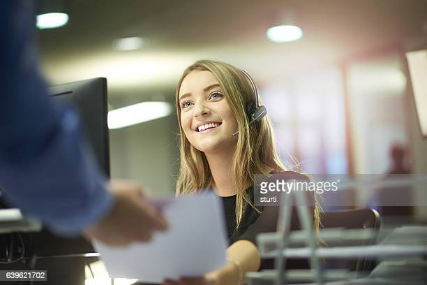 happy office intern - telecommunications equipment stock photos and pictures