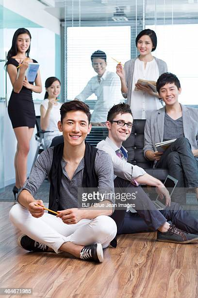 happy office workers - global fashion collective stock pictures, royalty-free photos & images