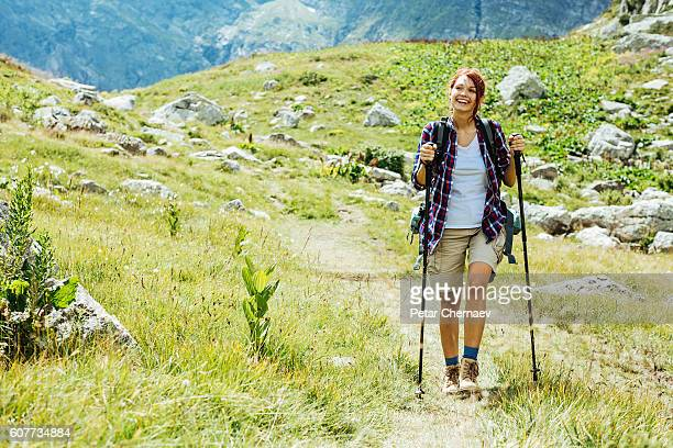 happy on the mountain footpath - hiking pole stock pictures, royalty-free photos & images