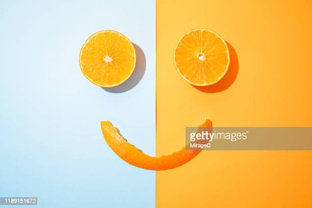 happy orange - colour block stock pictures, royalty-free photos & images