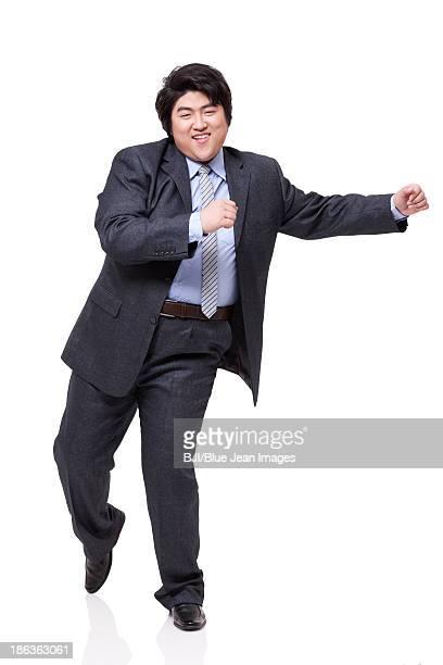 Happy overweight businessman dancing
