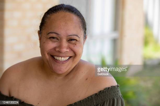 happy pacific islander female - minority groups stock pictures, royalty-free photos & images