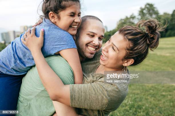 happy parenting moments - iberian ethnicity stock pictures, royalty-free photos & images