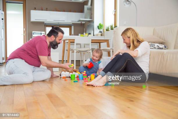 Happy parents playing with son