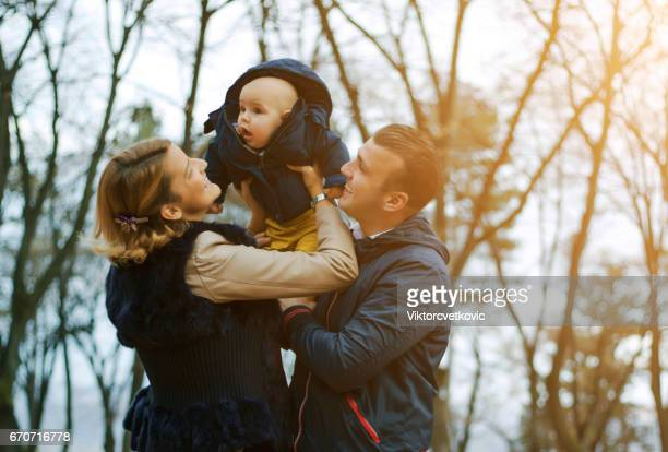 happy parents with child outdoors having a good family time - love you stock photos and pictures