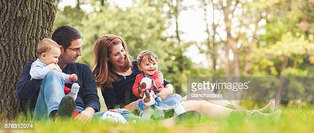 Happy parents with children outdoors having a good family time