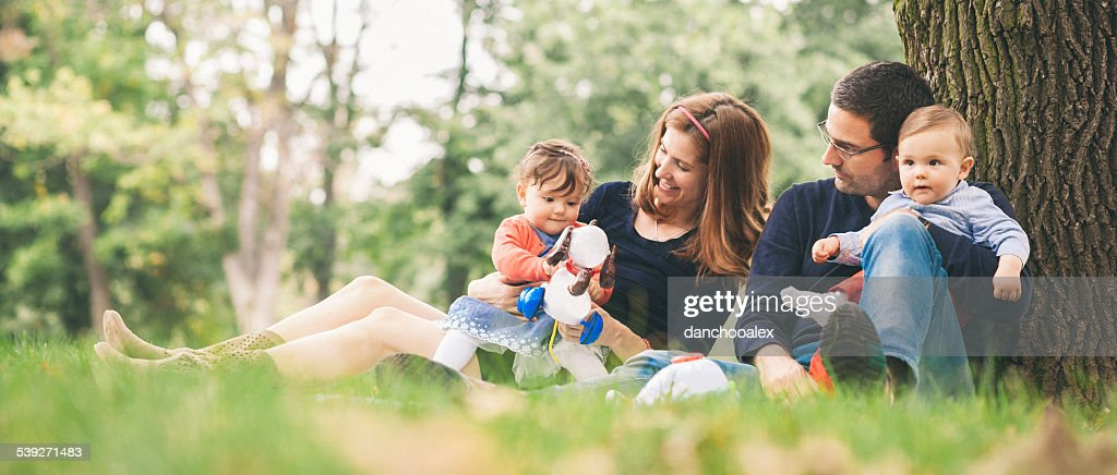 Happy parents with kids enjoying spring time in nature : Stock Photo