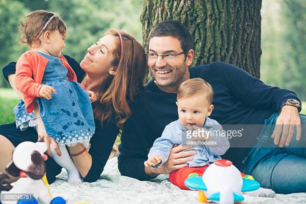 Happy parents with twin kids