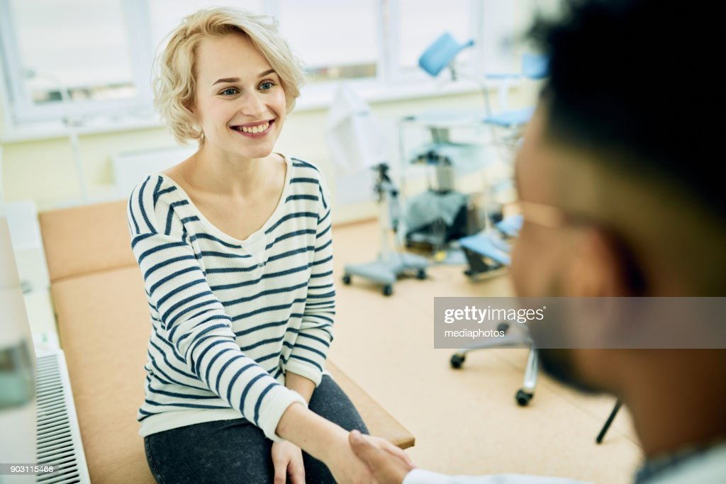 Happy patient visiting gynecologist : Stock Photo