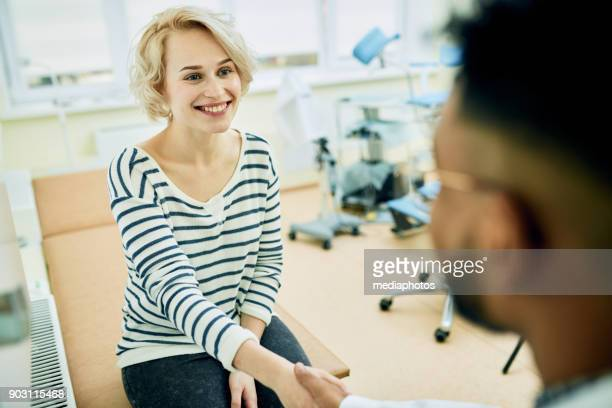 happy patient visiting gynecologist - pelvic exam stock photos and pictures