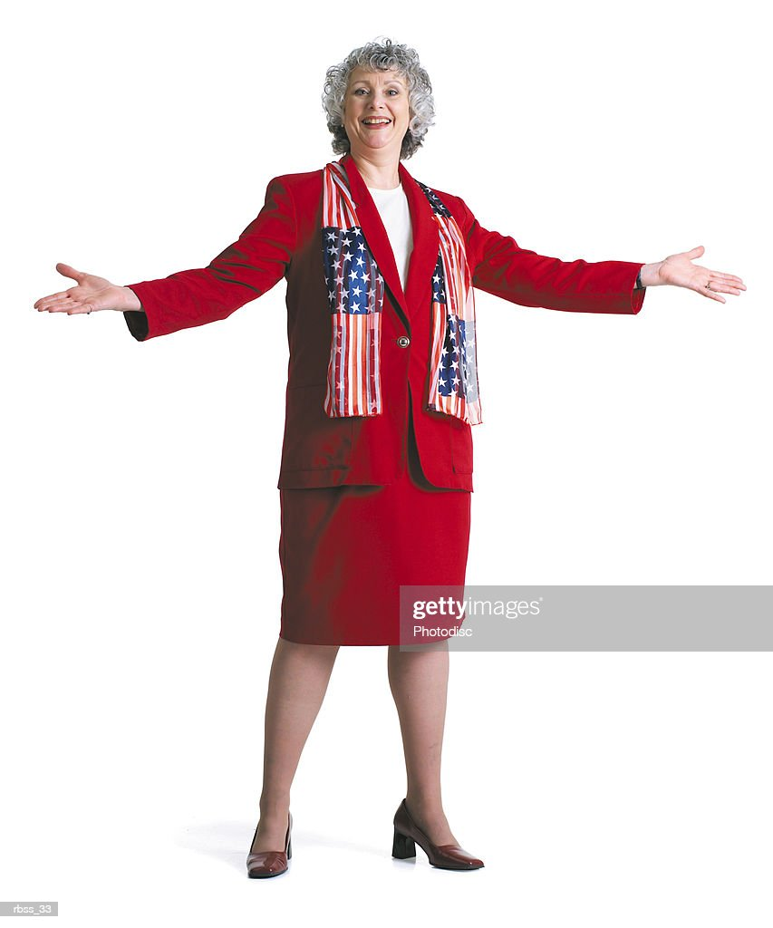 Happy patriotic woman smiles wearing a red dress and an American Flag scarf. : Foto de stock
