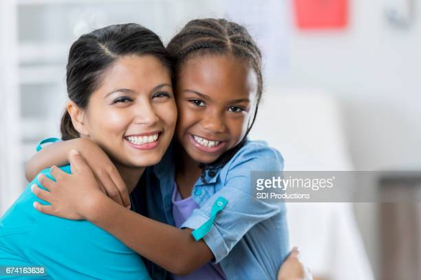 Happy pediatrician and patient