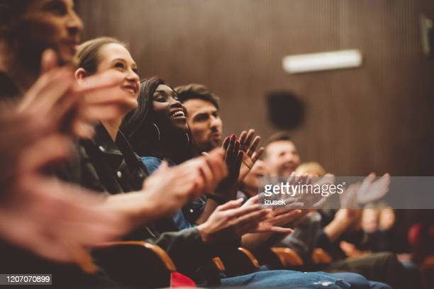 happy people applauding in the theater - theatrical performance stock pictures, royalty-free photos & images