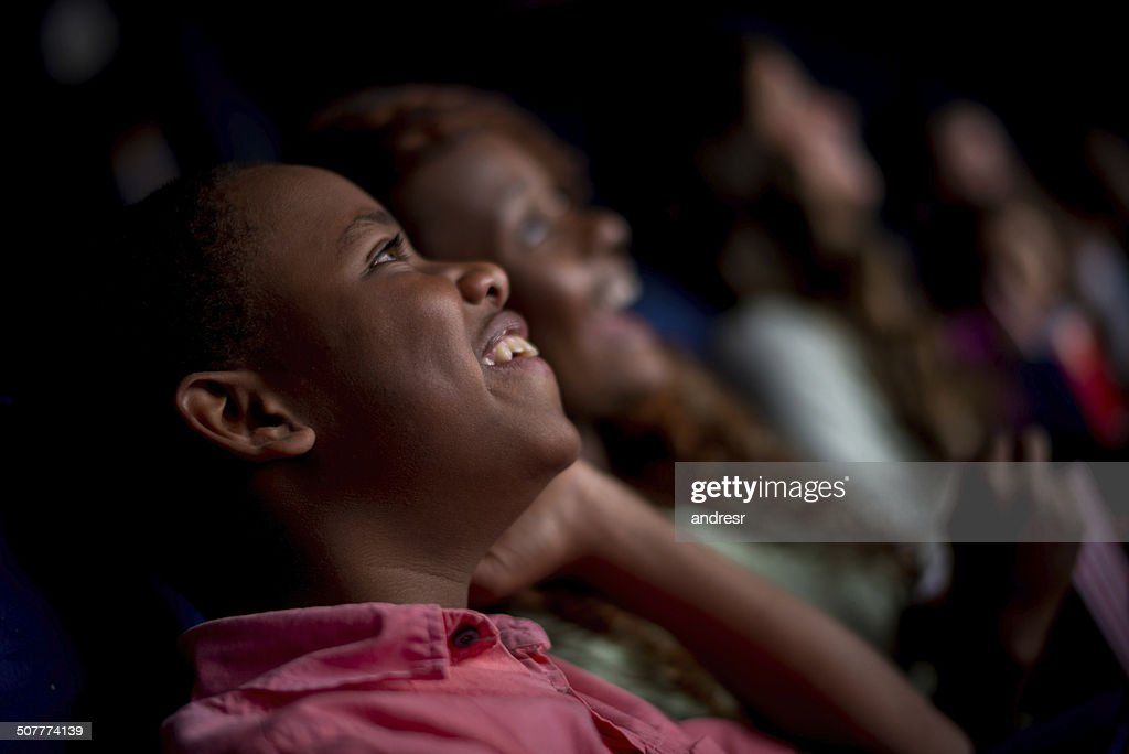 Happy people at the cinema : Stock Photo