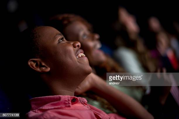 happy people at the cinema - adult film stock photos and pictures