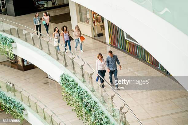 Happy people at the shopping center