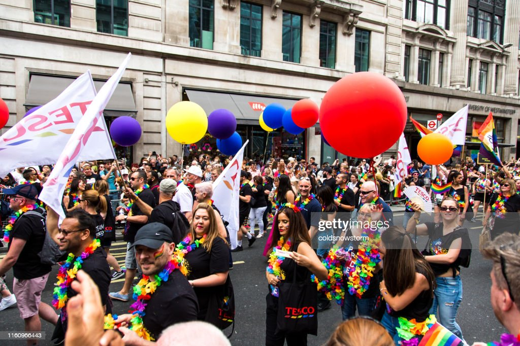 Happy people celebrating at Gay Pride Parade on streets of central London, UK : Stock Photo