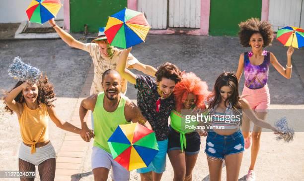 Happy people dancing at street carnival