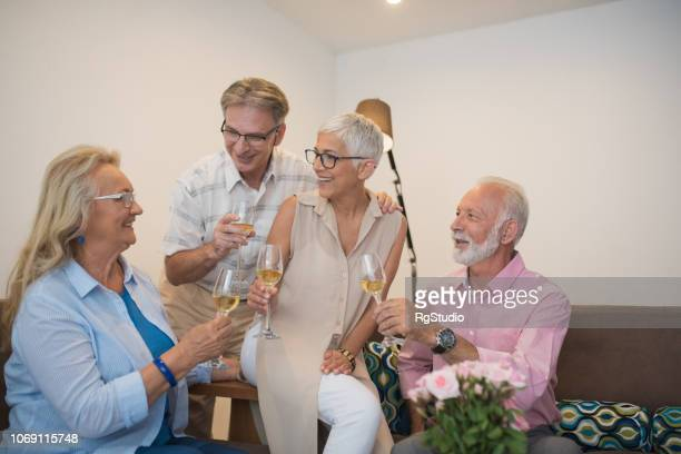 happy people drinking wine - drunk wife at party stock pictures, royalty-free photos & images