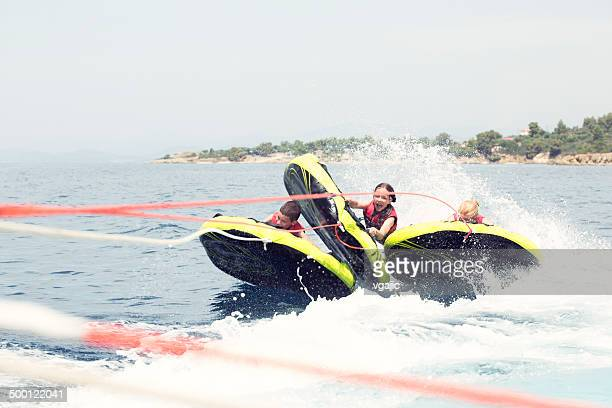 happy people enjoy water sports. - water sport stock photos and pictures